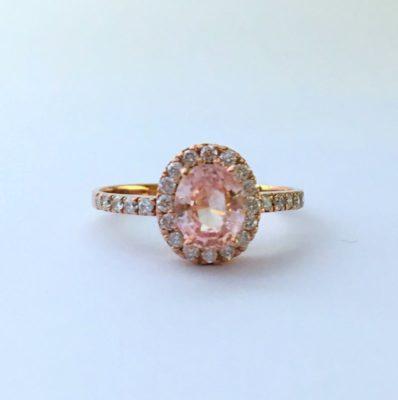 Oval peach sapphire ring halo