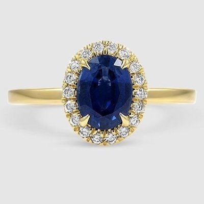 Oval halo blue sapphire ring