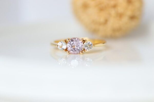 Three stone peach sapphire ring